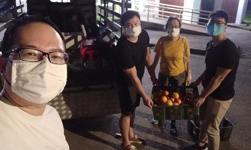 Retired financial adviser Daniel Tay and his friends, freegans who retrieve and reuse discarded items, collecting fruit during the seventh lunar month.