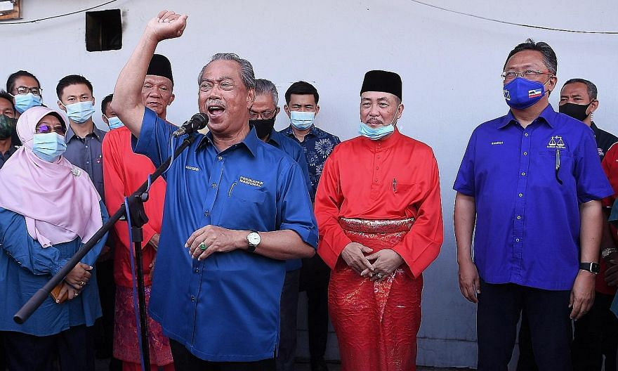 Malaysian Prime Minister Muhyiddin Yassin delivering a speech at a gathering before the nomination process for the state election at the Parti Pribumi Bersatu Malaysia office in Tuaran, Sabah yesterday. The Premier flew into the state early on Friday