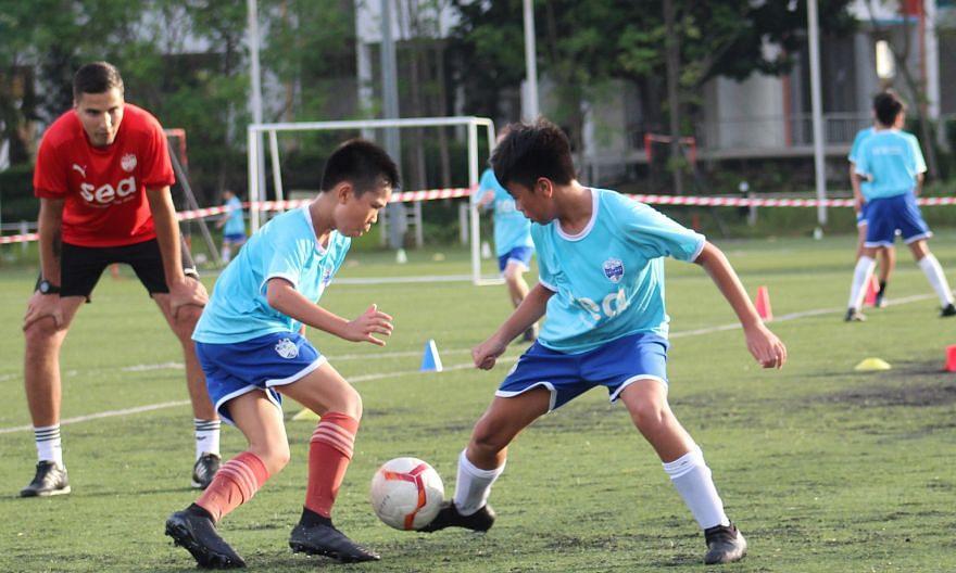 Lion City Sailors Football Academy director Luka Lalic casting a watchful eye on a training session with young players. The club planned to invest over $10 million in a new facility to groom more home-grown talent. PHOTO: LCS FOOTBALL ACADEMY