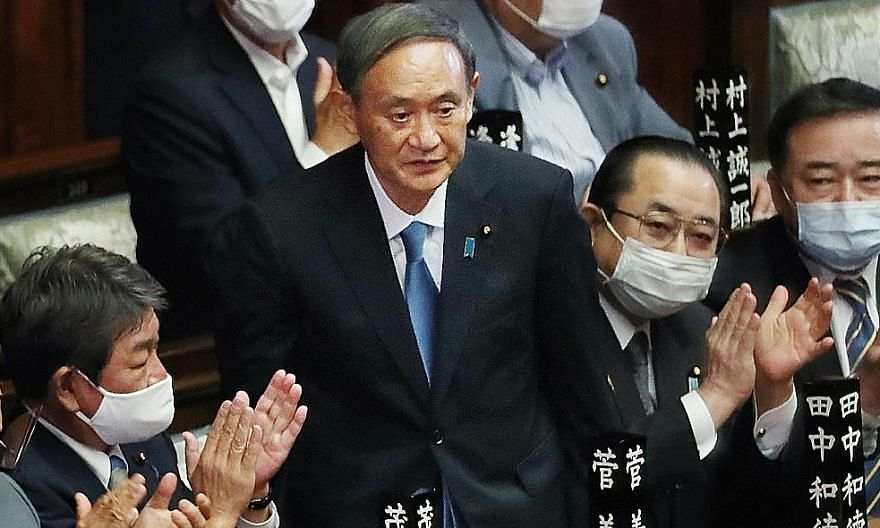 Mr Yoshihide Suga acknowledging lawmakers after he was elected Japan's prime minister on Wednesday. The Yomiuri Shimbun says in an editorial that it is hoped Mr Suga will exercise his leadership skills to solve a mountain of problems, including deali