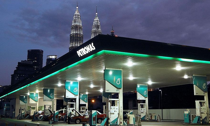 National oil company Petronas posted a quarterly net loss of RM21 billion (S$6.9 billion) for the period ended June 30, against a profit of RM14.7 billion in the same quarter last year. Economists note that the Malaysian government's reliance on Petr