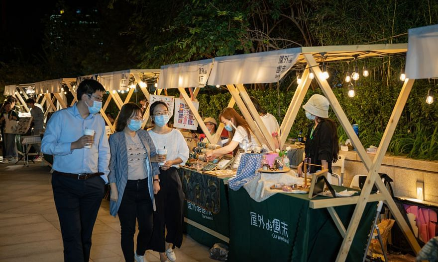 """People at a night market in Beijing last Friday. Asia's economic rebound would be """"strongly linked"""" to the recovery in the Chinese economy, says Mr Satish Shankar, the Asia-Pacific managing partner of business consultancy Bain & Company. China expand"""
