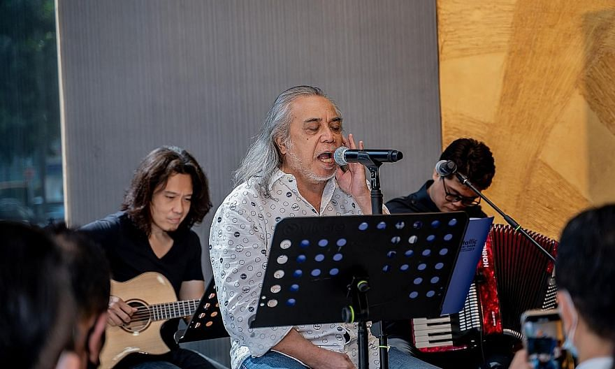 Music veteran Ramli Sarip (centre) giving a preview of his 23rd album by singing two folk-tinged songs that will be included, Cinta Di Sebalik Musim (Love Beyond The Seasons) and Srikandi Zaman (Heroines Of The Ages).