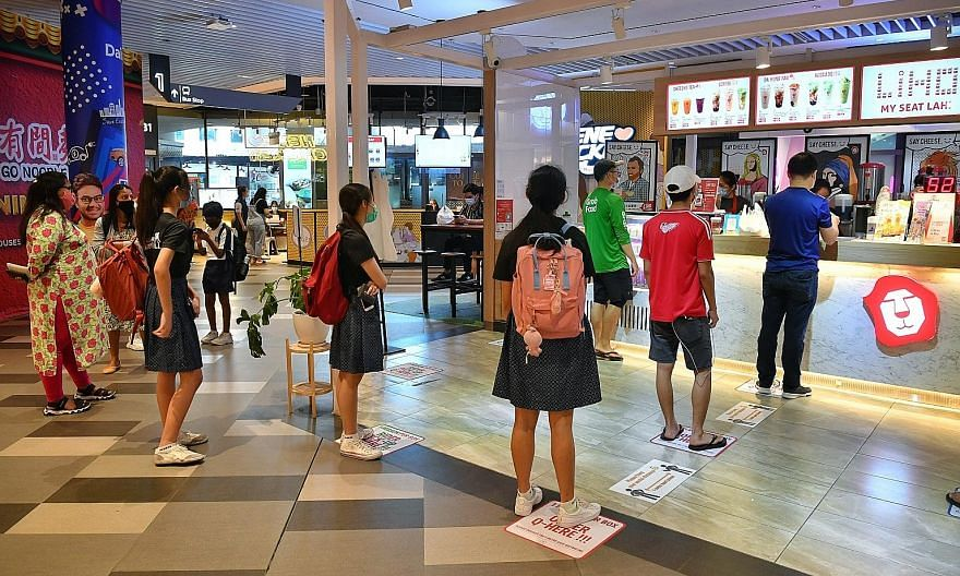 People queueing up to buy bubble tea while observing safe distancing at Our Tampines Hub on June 19, as Singapore moved into phase two of its reopening.