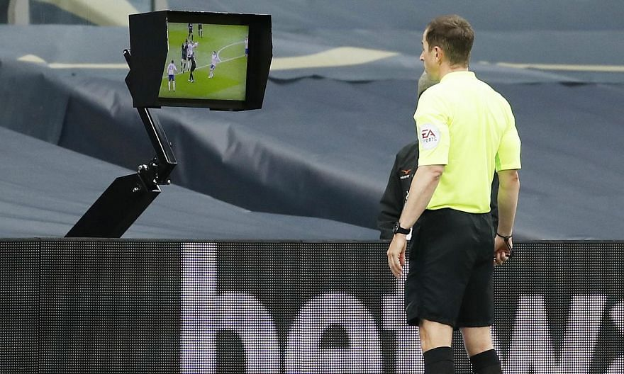 Referee Peter Bankes checking the video assistant referee monitor before awarding a hotly disputed penalty to Newcastle in added time, enabling the visitors to escape with a 1-1 draw at Tottenham on Sunday. The handball incident was the latest in a s