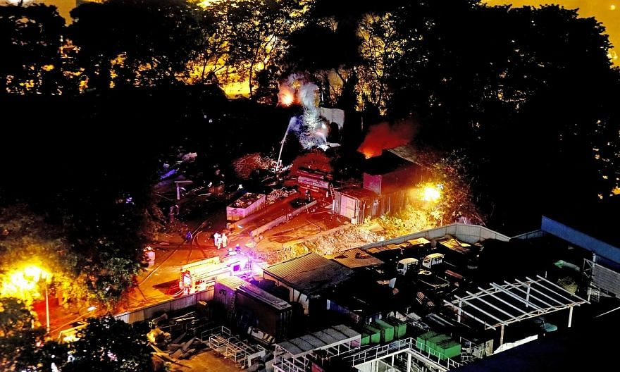 The SCDF battling the fire at 228A Mandai Estate last Thursday (top left) after being alerted at around 7.10pm. The factory is the site of World Metal Industries, a general waste disposal facility. A worker, Mr Wang Hai Tao, was injured and taken to