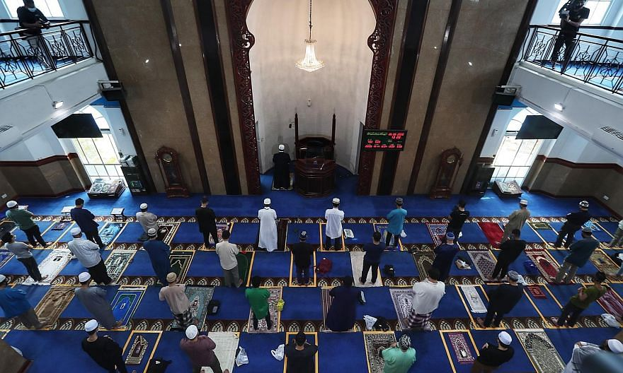 Worshippers at Masjid Al-Istighfar in Pasir Ris on June 26 when mosques resumed Friday prayers. The capacity for Friday prayers in some mosques will be raised to 250, as Muis looks to double the weekly spaces to 30,000.