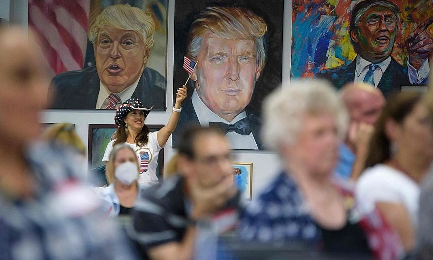 Supporters of US President Donald Trump watching the debate at the Trump Victory Campaign centre in Katy, Texas.
