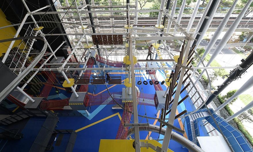 The new Home Team NS Khatib Clubhouse is home to Adventure HQ, a four-storey indoor hub complete with a mid-air obstacle course. The clubhouse also boasts a fully equipped gym. ST PHOTOS: ALPHONSUS CHERN