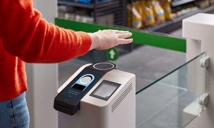 """A wave of the hand activates the palm recognition payment system called """"Amazon One"""" in Seattle, Washington. PHOTO: AGENCE FRANCE-PRESSE"""