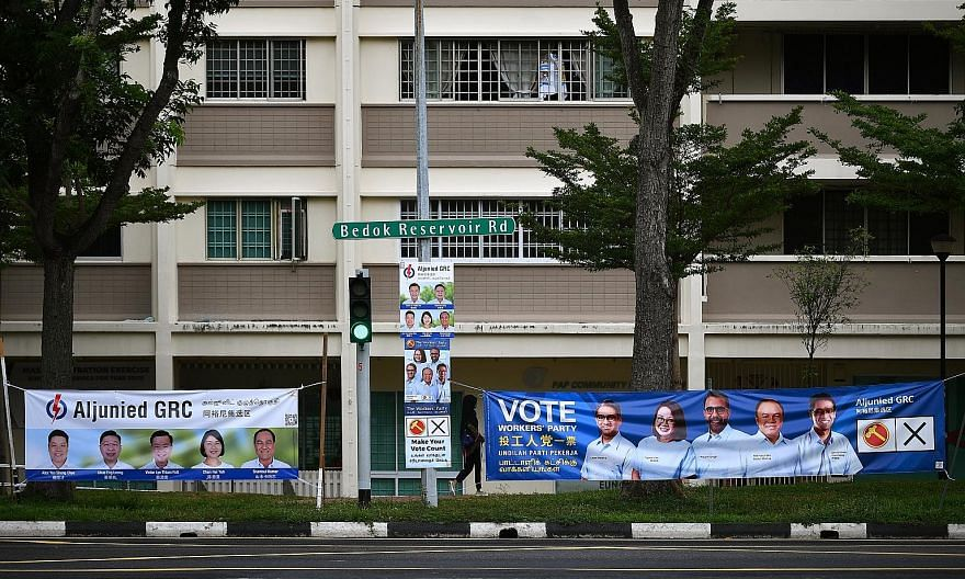 Election campaign banners for the People's Action Party and Workers' Party in Aljunied GRC in July. Across all age groups, there was a slide in the proportion of people who thought the ruling PAP was credible, while the opposite was true for the oppo