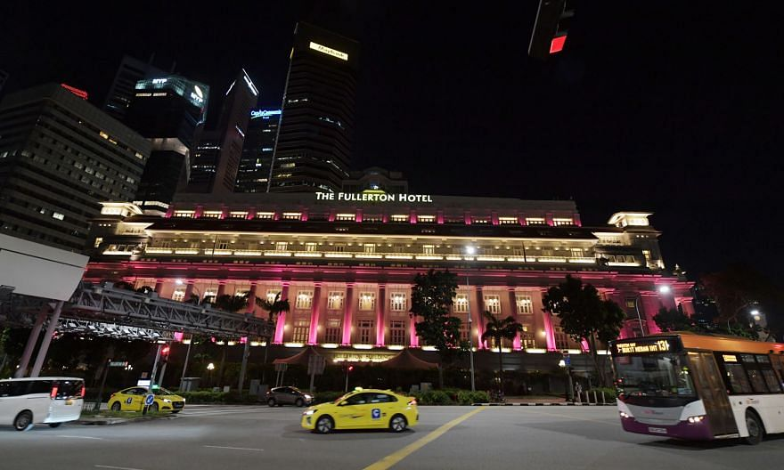 The pink light-up at The Fullerton Hotel Singapore was launched yesterday to kick off Breast Cancer Awareness Month, which falls in October. ST PHOTO: ALPHONSUS CHERN