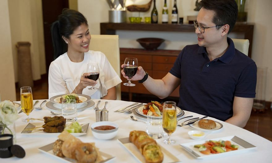 SIA@Home delivers first-or business-class meals to homes. First-class meals for two start at $448. Business-class meals for two start at $288. Both will include a bottle of wine and a pair of amenity kits. PHOTO: SINGAPORE AIRLINES