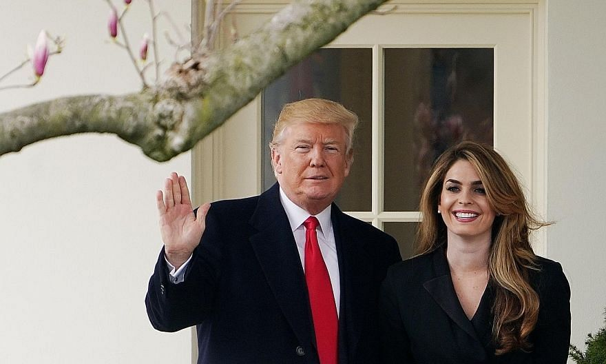US President Donald Trump with his close aide Hope Hicks, a former White House communications director, in a 2018 photo. Mr Trump's diagnosis came after news broke that Ms Hicks, who was among his entourage aboard Air Force One this week as they head