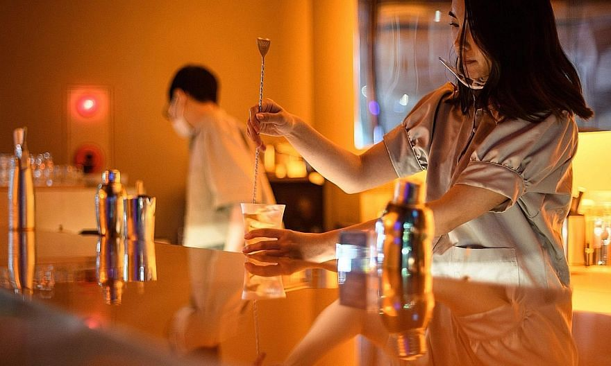 A bartender making a cocktail in a non-alcoholic bar in Tokyo. Booze-free bars are cropping up elsewhere in Japan, as Health Ministry data suggests heavy drinking is falling among young people.