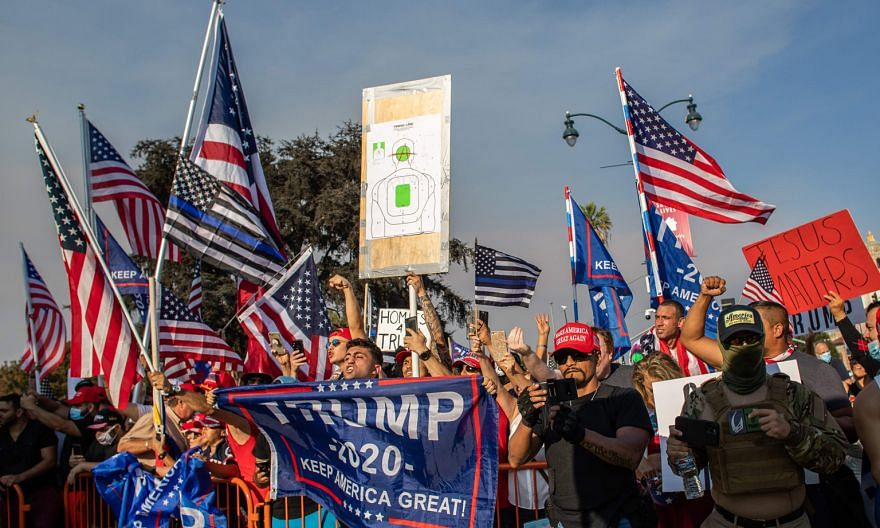 "People at a pro-Trump rally in Beverly Hills, California, last Saturday. To keep supporters energised, the Trump campaign is billing its next phase as ""Operation Maga"" - a mix of virtual events leading up to Wednesday's scheduled debate between Vice-"