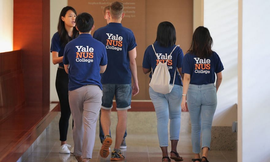 Students at the Yale-NUS College campus last year. Education Minister Lawrence Wong said yesterday in Parliament that no Singaporean is displaced from a university place because of an international student.