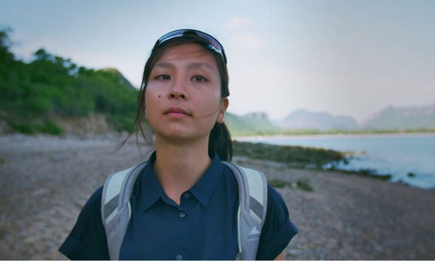 In the documentary Primates, researcher Amanda Tan (above) observes Thailand's long-tailed macaques, which use rocks as tools to crack open shellfish.