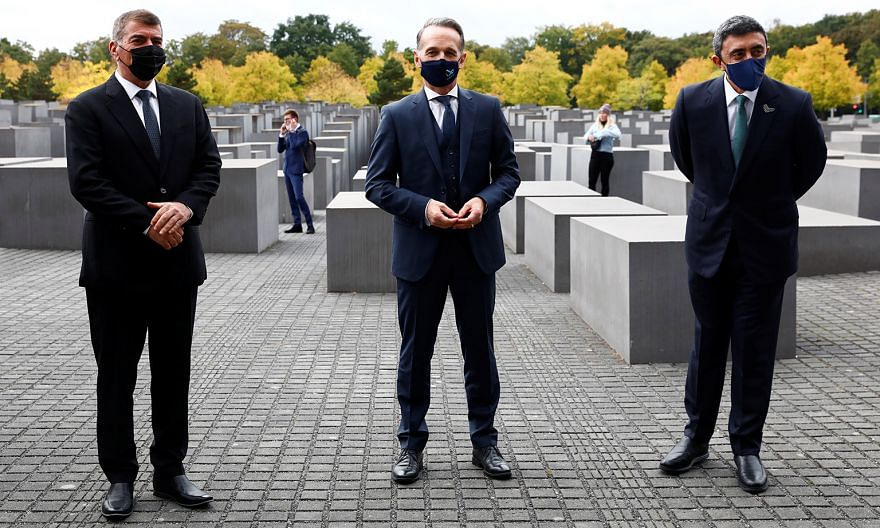 (From left) Israel's Foreign Minister Gabi Ashkenazi, German Foreign Minister Heiko Maas and UAE Foreign Minister Sheikh Abdullah bin Zayed al-Nahyan at the Holocaust Memorial in Berlin. It was the first face-to-face meeting for Mr Ashkenazi and Shei