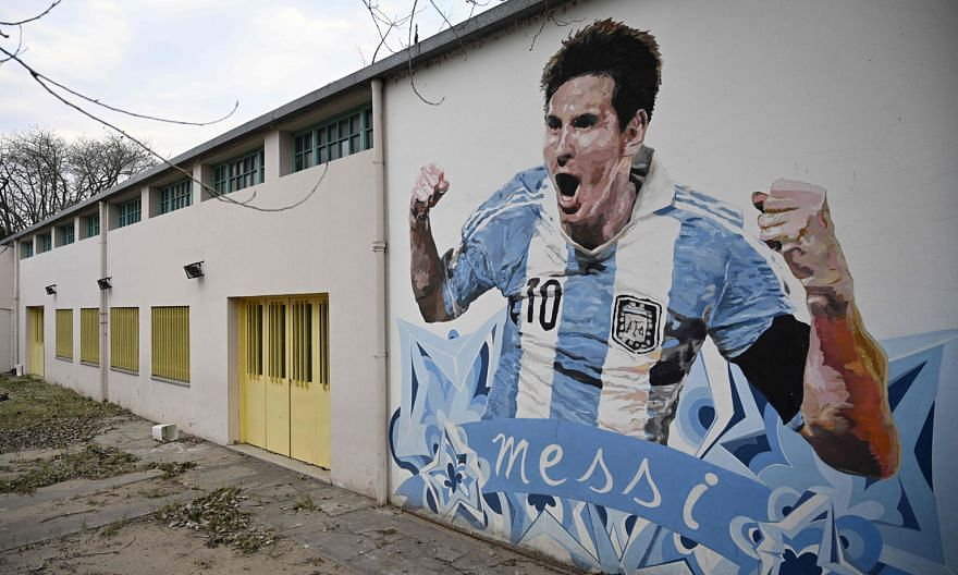 Lionel Messi, depicted in a mural in Buenos Aires, will lead Argentina out for the World Cup qualifier against Ecuador today.