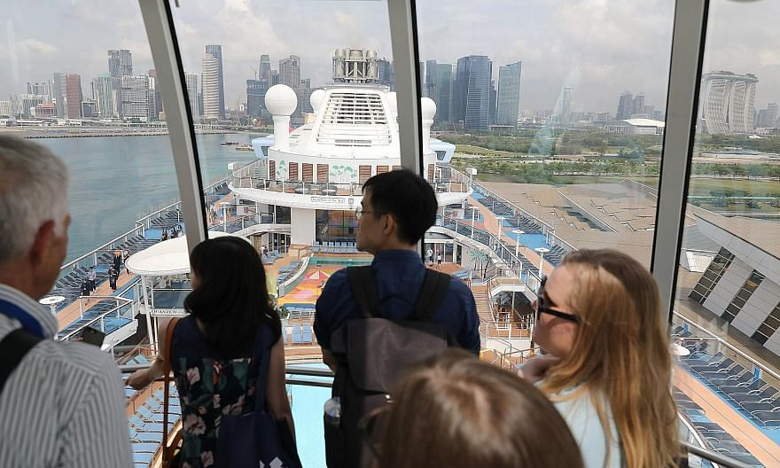 "Quantum of the Seas, seen here docked at Marina Bay Cruise Centre last year, is one of the ships allowed in a pilot ""cruise to nowhere"" from next month. While Singapore risks harming its economy if it does not return to some form of normalcy, when it"