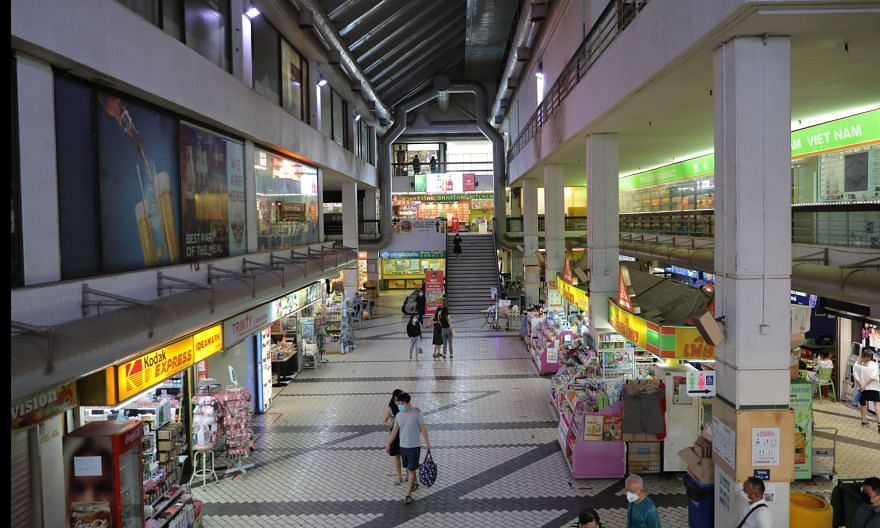 The retail atrium in Golden Mile Complex. The property was completed in 1973 and has about 48 years left on its lease. It was one of the first developments here to feature offices, shops and residences.
