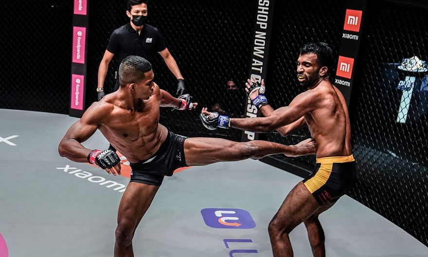 Singaporean MMA fighter Amir Khan landing a kick on India's Rahul Raju at One Championship's Reign of Dynasties event last night. Amir knocked out his opponent in the first round.