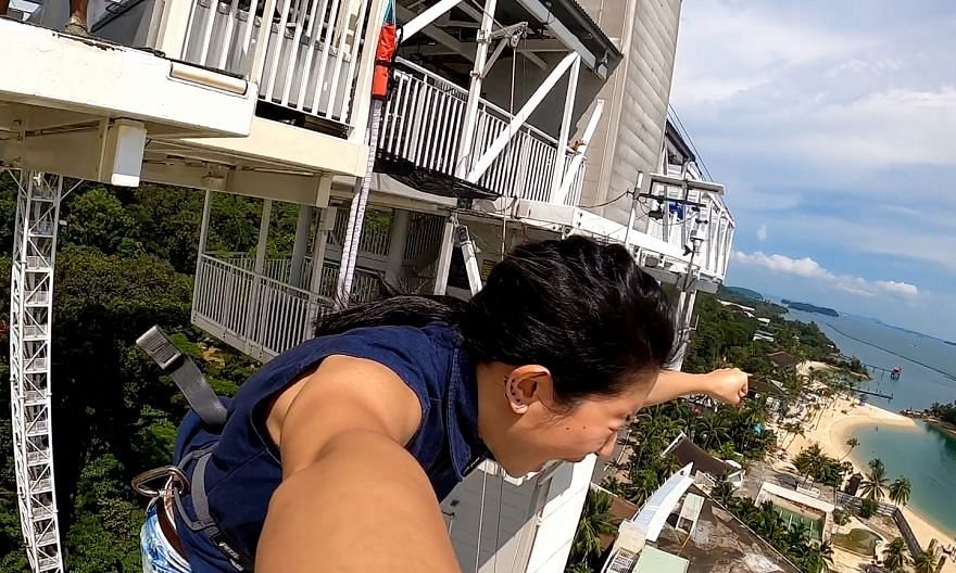 The writer finally letting go of her fear and leaping off from the bungee jump tower.