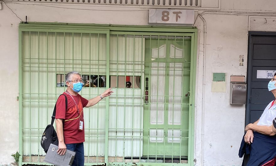 Tourist guide Chris Ng pointing out an active brothel (above) in Keong Saik Road. The tour also stops at 17A Keong Saik Road, the subject of the 2017 memoir of the same name by Charmaine Leung, about her mother who grew up in a brothel in the 1970s.