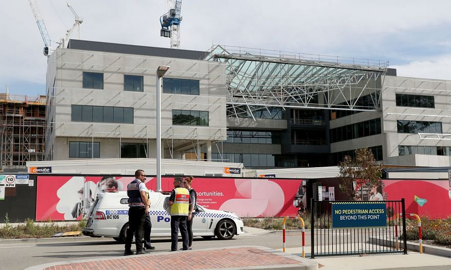 Emergency services at the scene of the collapsed building in Curtin University in Perth, Australia, yesterday. One person died and two men were hospitalised with multiple injuries.