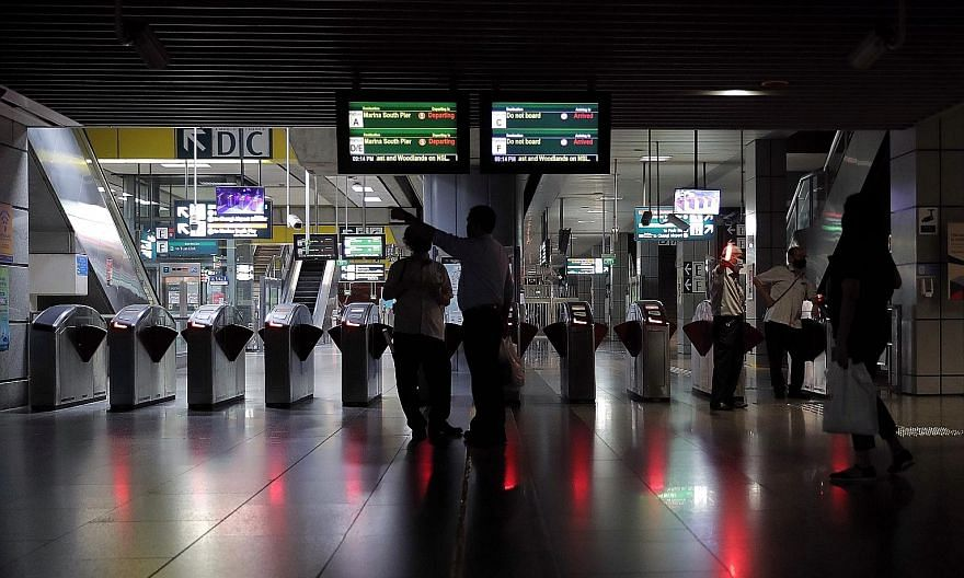 The 31/2-hour breakdown along parts of the North-South, East-West and Circle MRT lines caused by a faulty power cable led to blackouts at stations such as Jurong East (above), where commuters stranded in trains were guided by SMRT staff to walk along