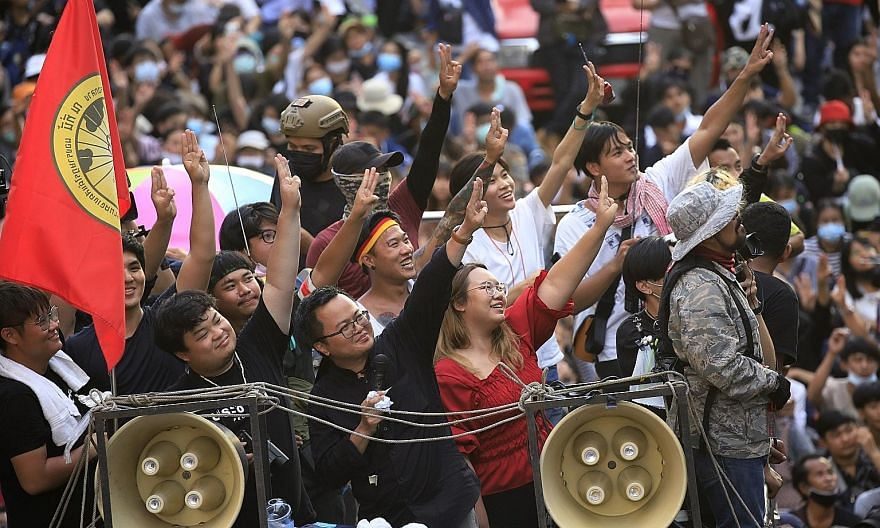 Thai human rights lawyer Anon Nampa (centre) and other activists flashing the three-finger anti-dictatorship salute from a truck during an anti-government protest in Bangkok yesterday. PHOTO: EPA-EFE
