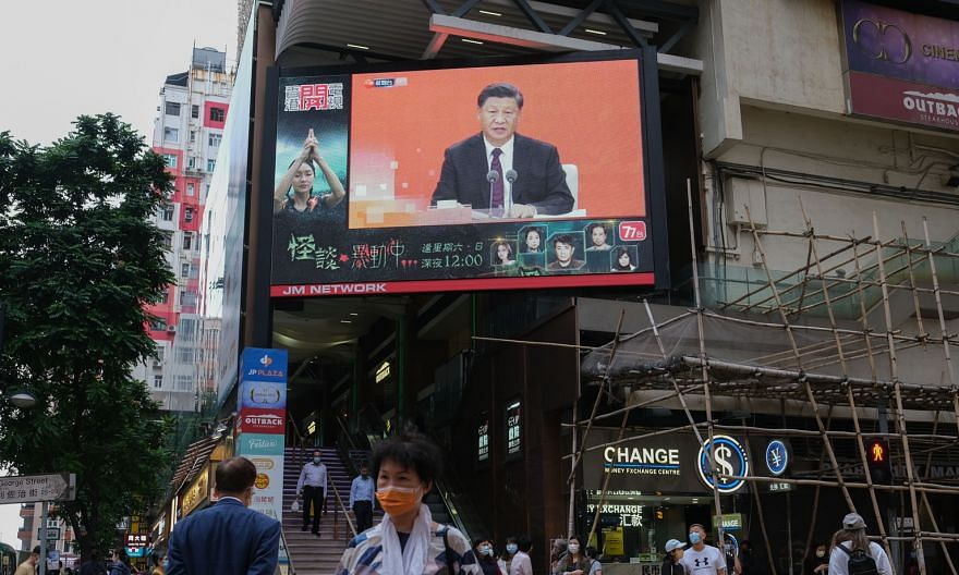 A giant TV screen in Hong Kong showing Chinese President Xi Jinping making a speech in Shenzhen yesterday to mark 40 years since the city pioneered a special economic zone that helped propel its exponential growth.