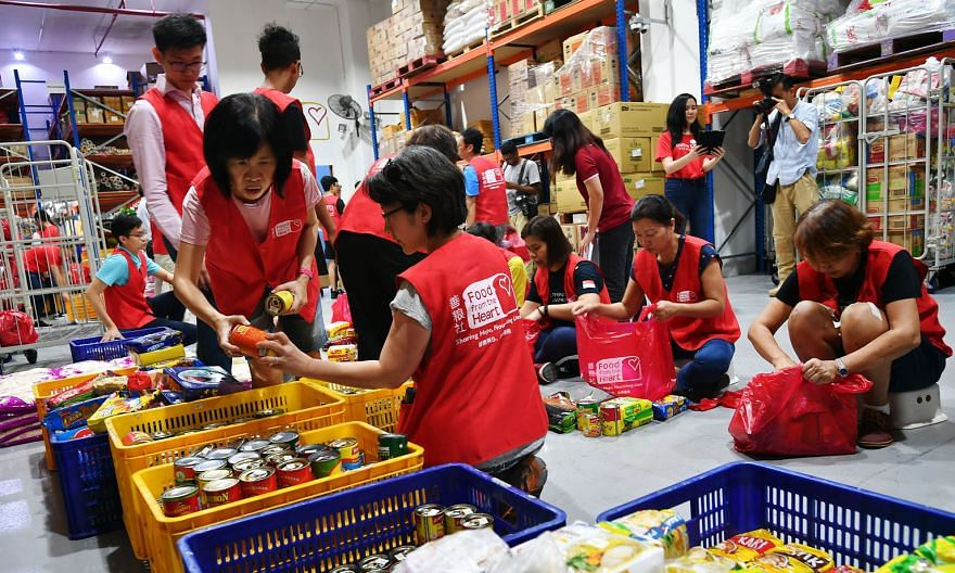 Volunteers helping to pack food at Food from the Heart in February. Deputy Prime Minister Heng Swee Keat praised ground-up community movements founded to help those in need, and encouraged those who could to continue donating generously during this p