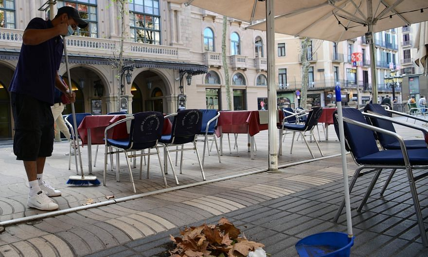 The outdoor seating area of a restaurant in the Spanish city of Barcelona where bars and restaurants have been ordered closed for 15 days from yesterday to curb a surge in coronavirus cases. The International Monetary Fund projects a partial and unev