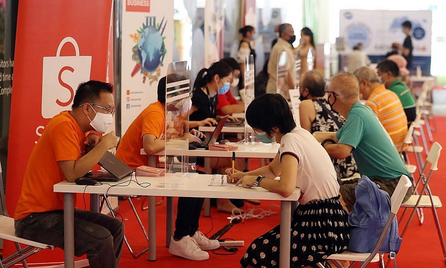 Out of the 1,400 jobs on offer at the career fair in Our Tampines Hub, 280 were for professional, manager, executive and technician (PMET) roles. Other forms of support for job seekers were available from social agencies and organisations which also