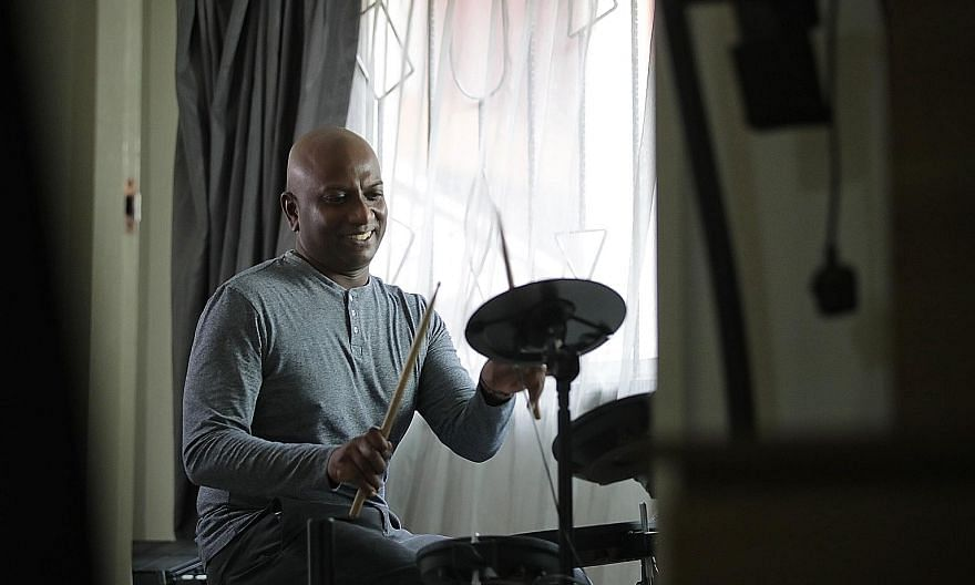 Music educator Vicknes Vinayak Veerappan, 46, drumming in his Bishan home studio last Wednesday. In 2017, he decided to first take up a diploma in law as a foundation for his subsequent degree. It gave him insight into copyright and intellectual prop
