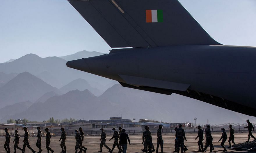Indian soldiers disembarking from a military transport plane at a forward airbase in Leh, in the Ladakh region, last month.