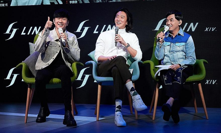 Singaporean singer JJ Lin (far left) with Taiwan-born singer Harry Chang (centre) and Taiwanese host Mickey Huang (left) in Taipei at the global listening party.