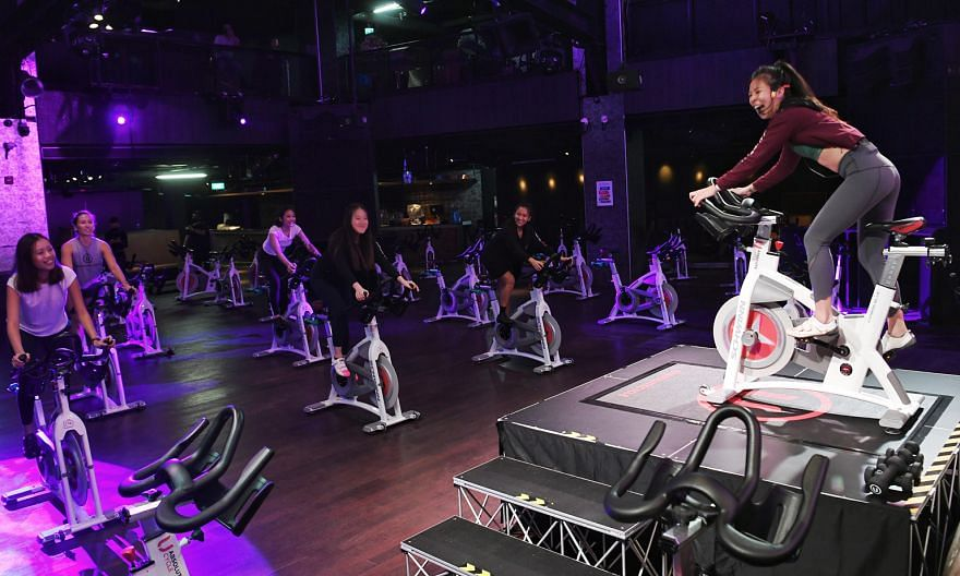 Zouk nightclub's dance floor, which has been transformed into a spin studio. Education Minister Lawrence Wong said there will be measures to help nightlife businesses exit, transit and pivot to new areas. ST PHOTO: KHALID BABA