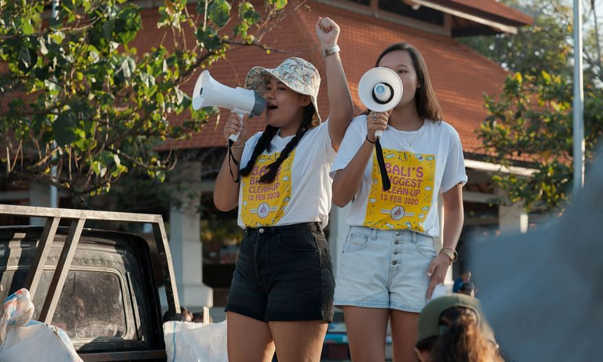 The Wijsen sisters Isabel (left) and Melati making their pitch for the environment during Bali's Biggest Clean-Up event in February. They started their Bye Bye Plastic Bags initiative seven years ago.