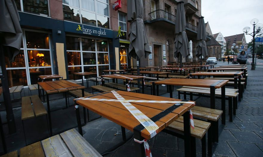 An empty restaurant terrace in Nuremberg, Germany, on Monday. The number of new Covid-19 cases in the country rose by 8,397 yesterday, the highest since the pandemic began. PHOTO: BLOOMBERG