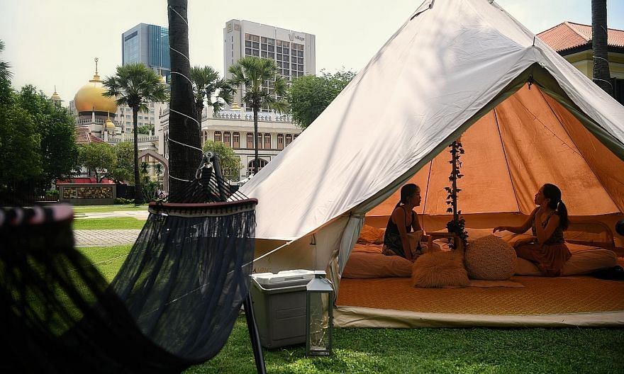 "One of the two tents for the two-day, one-night ""glamping"" experience at the Malay Heritage Centre - between Dec 15 and 24 - is equipped with two queen-sized beds and a hammock, while another tent provides a space to watch movies with a projector scr"
