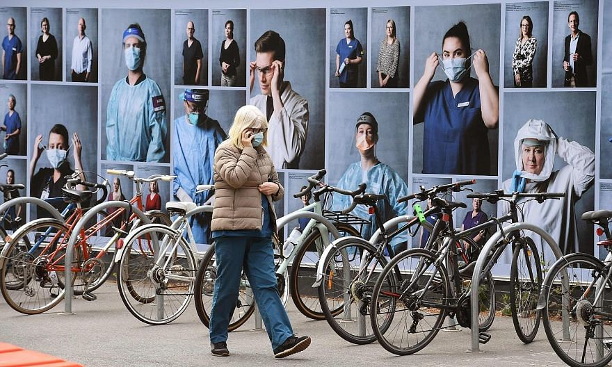 A photo display put up to thank healthcare workers outside the Royal Melbourne Hospital in Melbourne, Victoria's capital. Just three new Covid-19 cases were reported in the Australian state yesterday, a dramatic turnaround from early August, when the