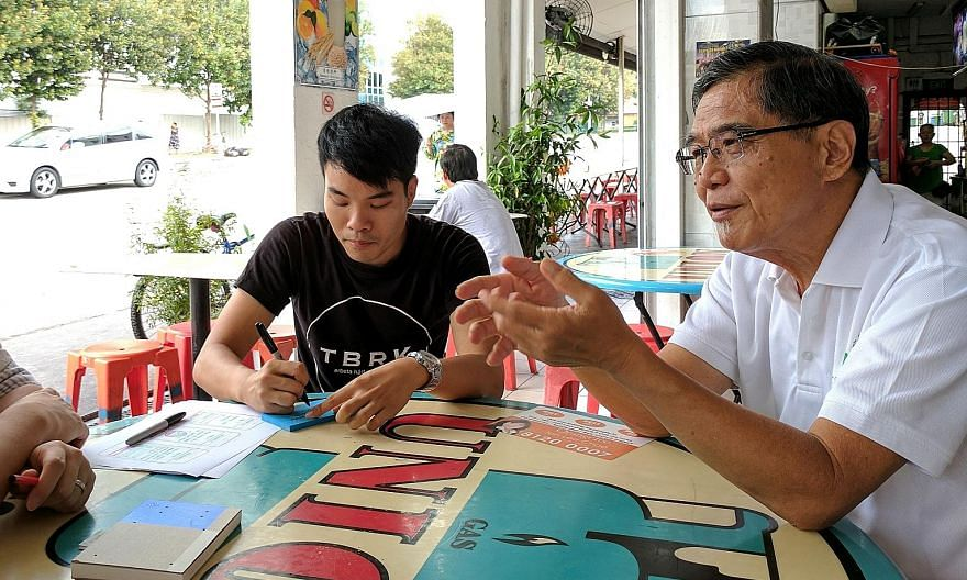 GovTech user experience designer Chew Kia Hwee (left) conducts citizen research by engaging with seniors, such as retiree Lim Ah Swan, and other users to ensure their needs and concerns are addressed in the design of the SingPass Mobile app. PHOTO: G