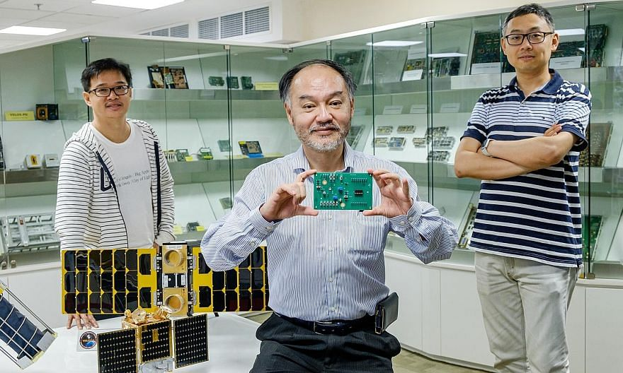 Professor Joseph Chang (centre) of Nanyang Technological University holding the Latchup Detection and Protection chip launched by Zero-Error Systems (ZES). With him are Dr Chong Kwen Siong (left), ZES co-founder, and Dr Shu Wei, ZES chief technology