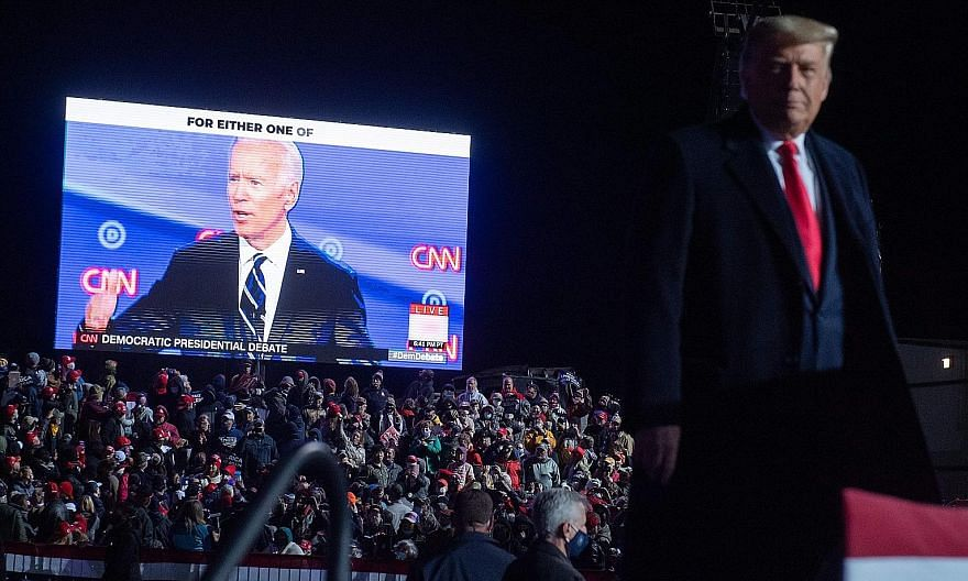 US President Donald Trump watching a video of Democratic presidential nominee Joe Biden during a campaign rally at Erie International Airport in Pennsylvania, on Tuesday. Polls conducted by The Financial Times and The New York Times suggest that like