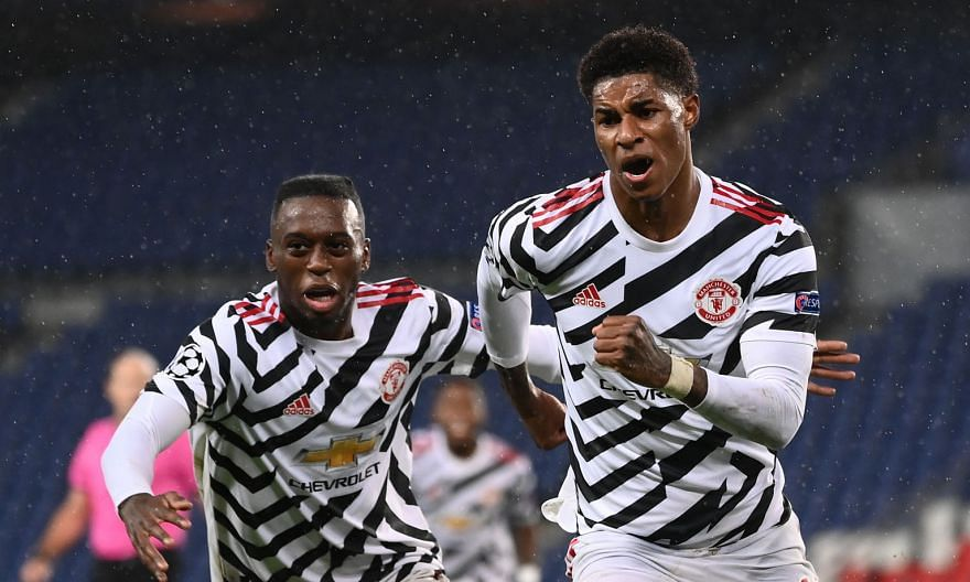 Manchester United forward Marcus Rashford celebrating with defender Aaron Wan-Bissaka (far left) after scoring a late winner against Paris Saint-Germain on Tuesday. The 2-1 win means United are now tied on three points with RB Leipzig at the top of G