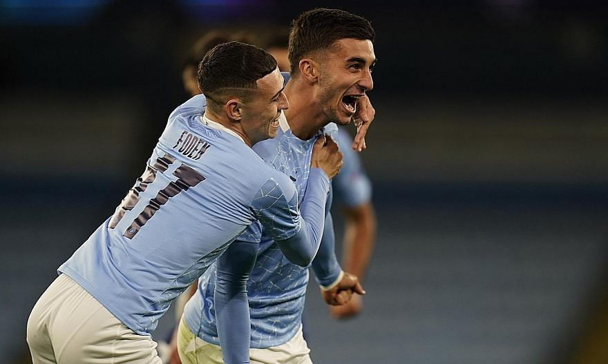 Ferran Torres celebrating with Phil Foden after sealing City's 3-1 win over Porto in Wednesday's Champions League game at the Etihad Stadium. PHOTO: REUTERS