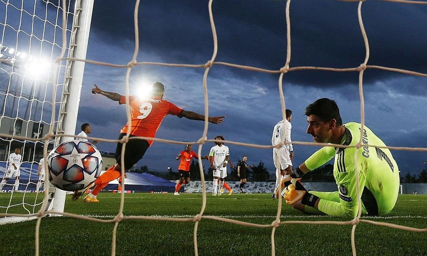 Real Madrid goalkeeper Thibaut Courtois watching forlornly as teammate Raphael Varane scores an own goal in the 3-2 loss to a depleted Shakhtar Donetsk in the Champions League. It was the Ukrainian side's first win over Real. PHOTO: REUTERS